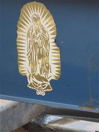 The virgin of Guadalupe also adorned the tow truck.