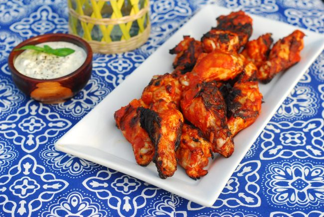 Sriracha paired with chipotle peppers in adobo make for a tasty combo in this recipe which are cooled down with a creamy blue cheese dipping sauce.