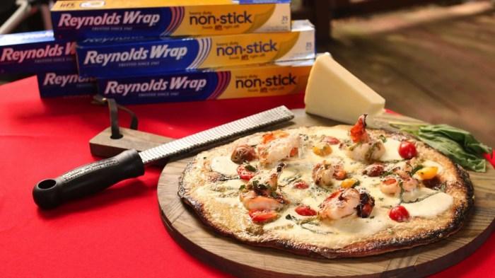 Shrimp, basil, cherry tomato, basil pest and fresh mozzarella pizza