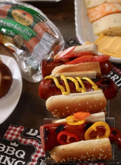 Grilled Kielbasa halves in half hot dog buns