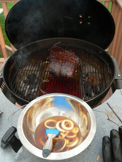 Smoking a pork shoulder on a charcoal grill