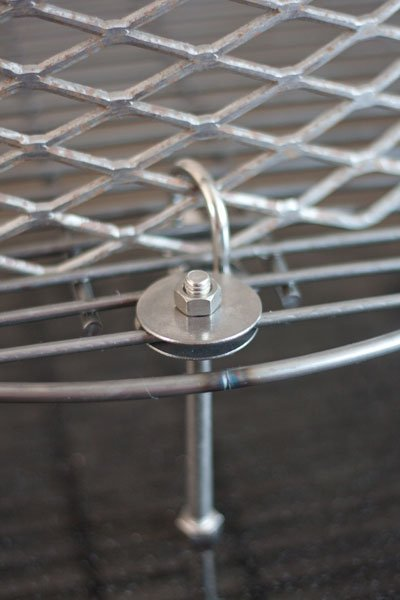 Attaching an expanded steel basket to a charcoal grate for a BBQ smoker - Ugly Drum Smoker Build - Grilling24x7.com