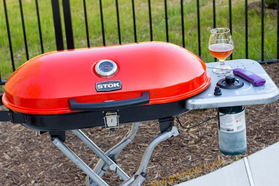 Grilling a steak on a small tailgate grill - Stok Gridiron Review