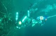 Extraen 850 kilos de basura del cenote de Tabi, en Sotuta