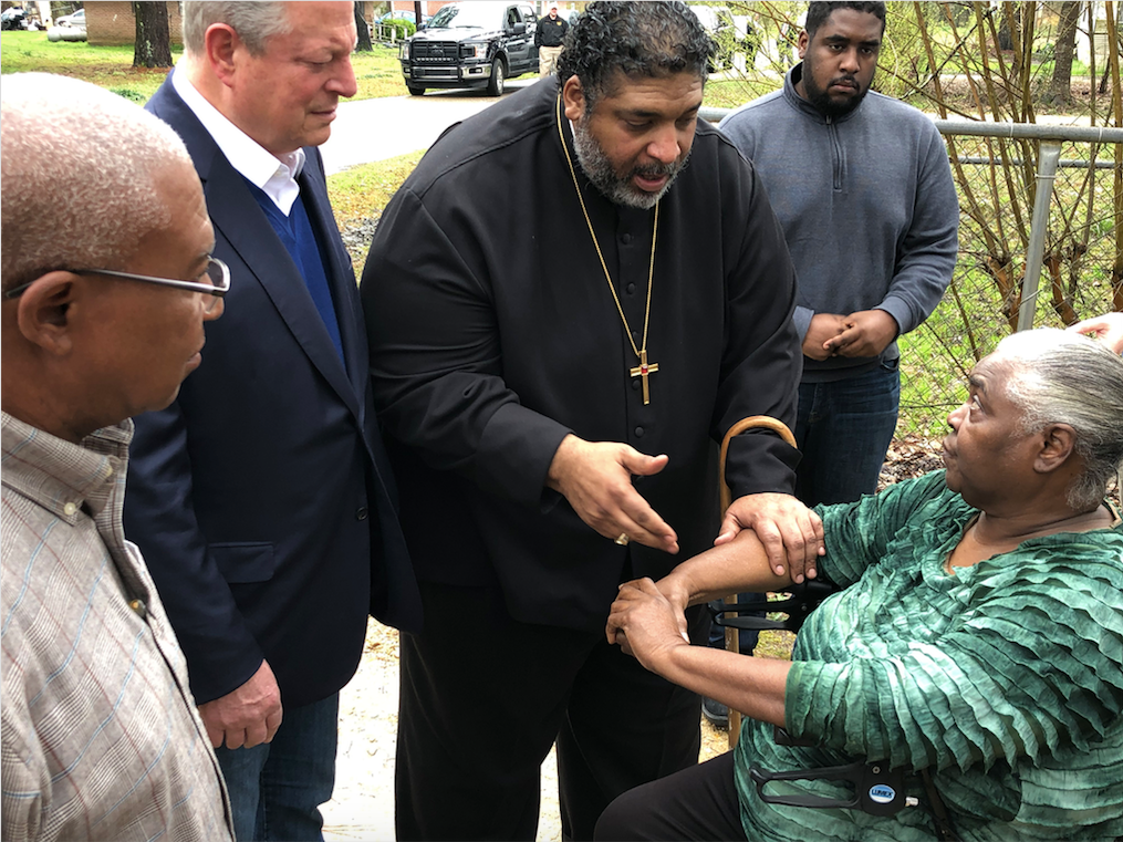 Former Vice President Al Gore and Reverend William Barber II speak with Lowndes County resident Charlie Mae.
