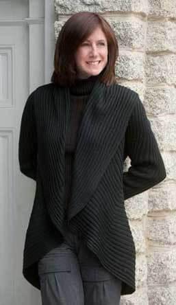 black alpacas essential sweater on female model