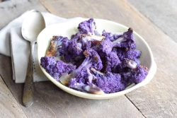 Roasted Purple Cauliflower in a white bowl