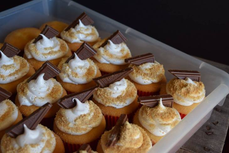 Smores cupcakes in a plastic container for transport