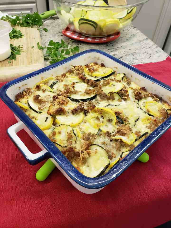 Sausage Squash Casserole with silicon trivet foldable