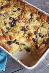 Honey Bread PUdding with raisins in a whi