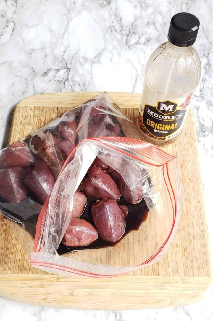 Marinating dove breasts in Moores sauce in a zip top bag