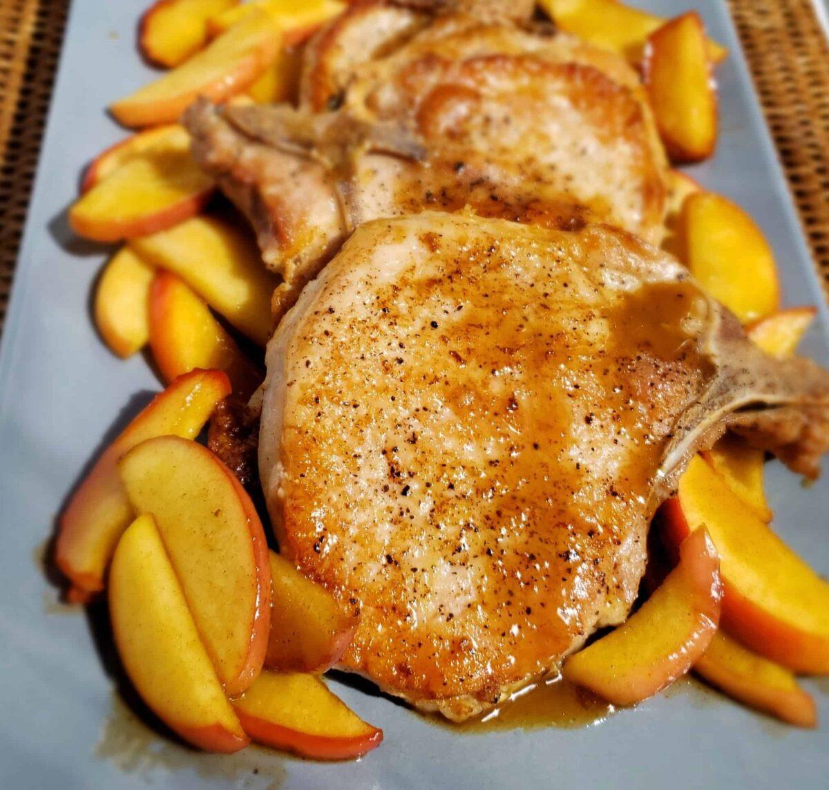 Pork Chops sauce on chop Apples on platter