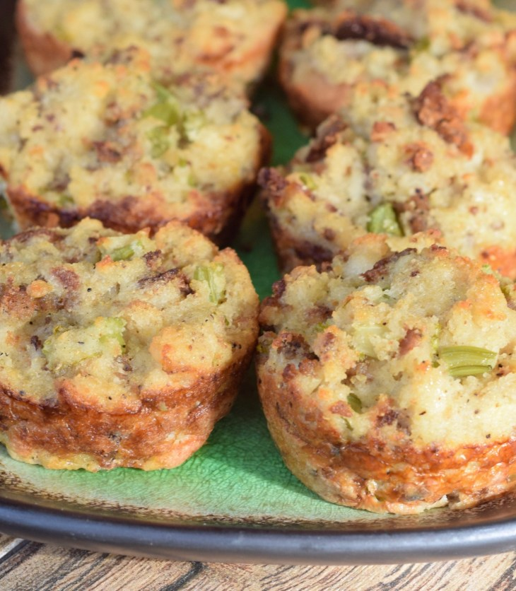 Individual size sausage cornbread dressings baked in a muffin pan and served on a green platter Pinterest Pin
