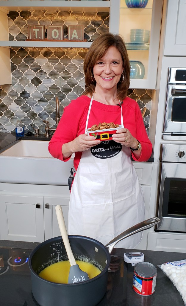 3 Ingredient Cinnamon Sugar Toasted Pecans made on Talk of Alabama morning show, Kathleen Phillips is holding a santa bowl of them.