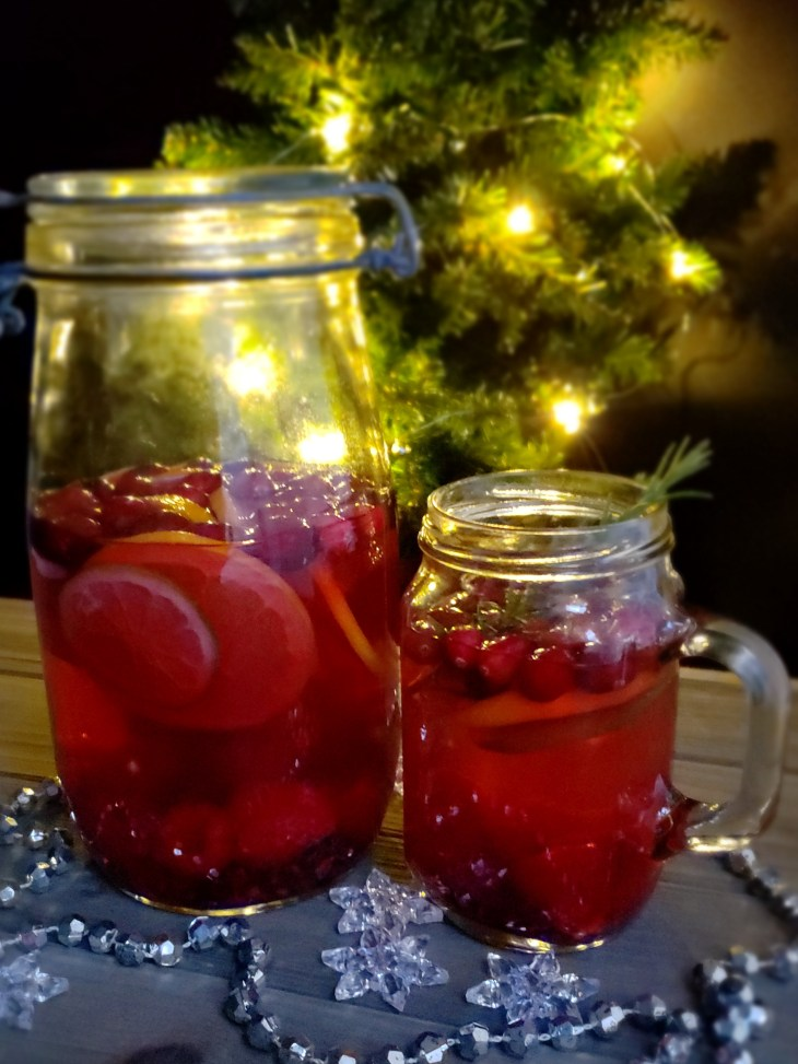 "Serve Sweet Tea Sangria ""Skinny"" Mocktail at a Christmas tree trimming party at night."