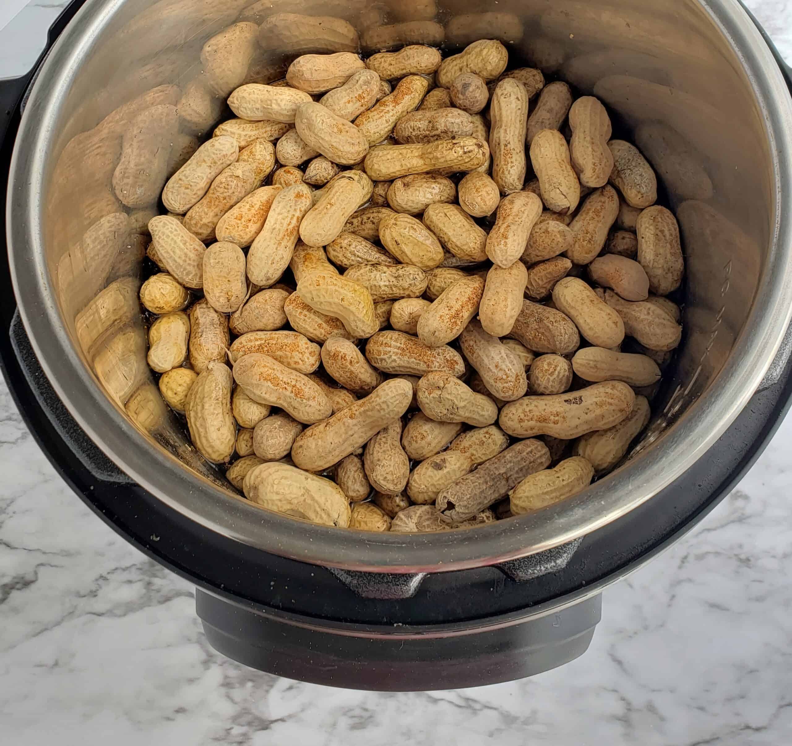 For boiled peanuts add one pound raw peanuts, 1/4 cup salt and 6 cups water to the 6 quart Instant Pot. Add Tony Cacheres creole seasoning to the Instant Pot f desired
