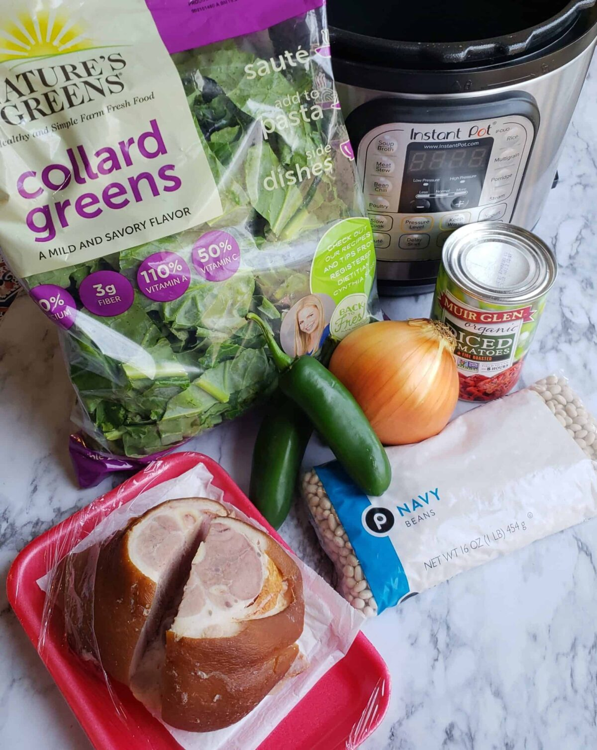 Ingredients for Instant Pot Collard Greens and Beans: Bag of collard greens, can of tomatoes, ham hock, jalapeno peppers, onion, dried Navy beans