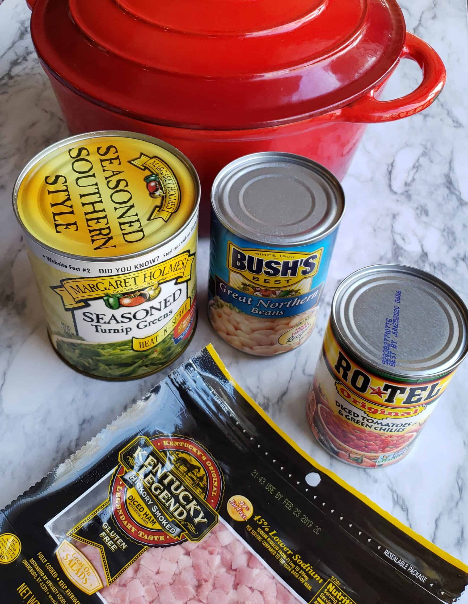 Shortcut Turnip Greens Soup is made with just 4 ingredients and 3 of them are cans of veggies but it tastes like fresh greens were cooked low and slow all day. Cans of turnip greens, great northern bean, Rotel tomatoes, diced ham with a red cast iron dutch oven.