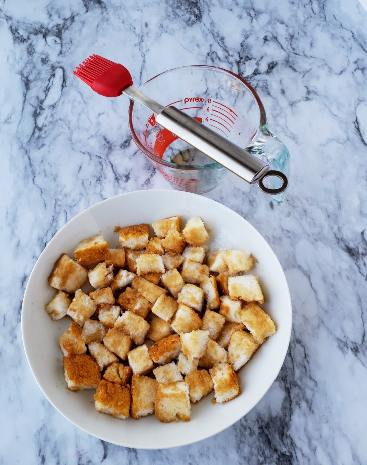 Brush or drizzle the concentrated tea mixture over the cubed angel food cake. The cake will absorb it very quickly.