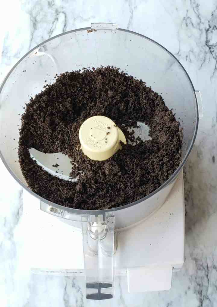 Fine Mint Oreo cookie crumbs in a food processor