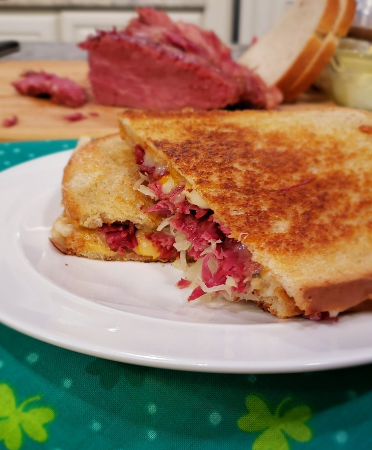 Building a Reuben Sandwich with Instant Pot Corned Beef is easy by layering it with shredded Swiss cheese and sauerkraut. Slather the inside of the bread with Russian or Thousand Island Dressing. I like to cook mine on a griddle or skillet like a grilled cheese to melt the cheese.