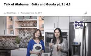 two ladies in kitchen, one with apron on, tv studio kitchen