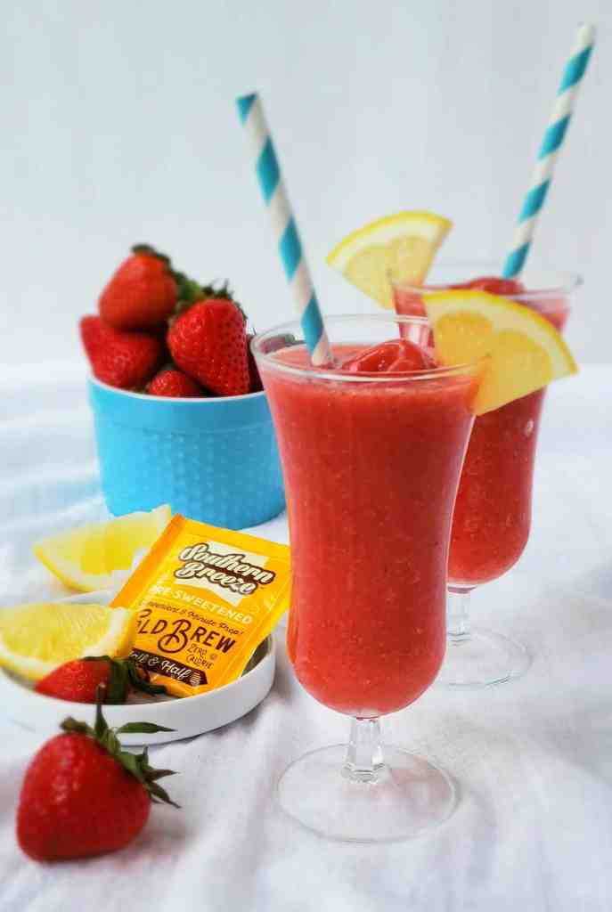 strawberry frozen lemonade with blue bowl of strawberries