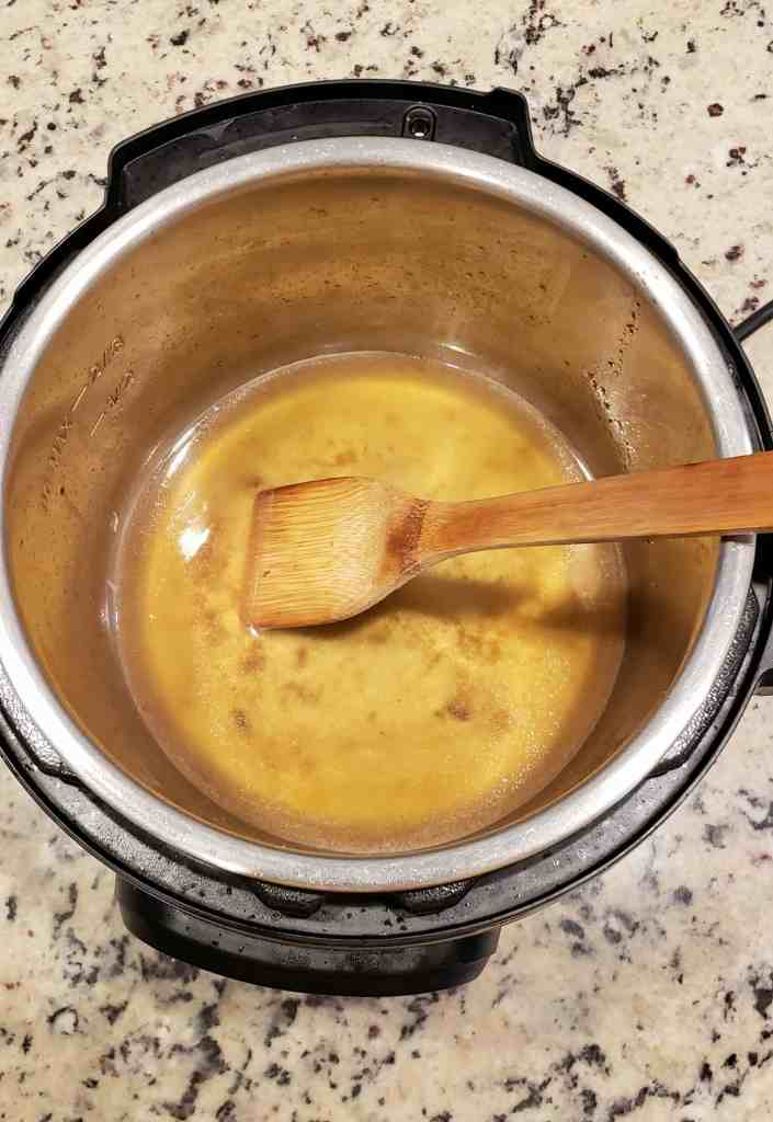 Add water to the Instant Pot and gently scrape the bottom with a wooden spoon to remove the browned bits.