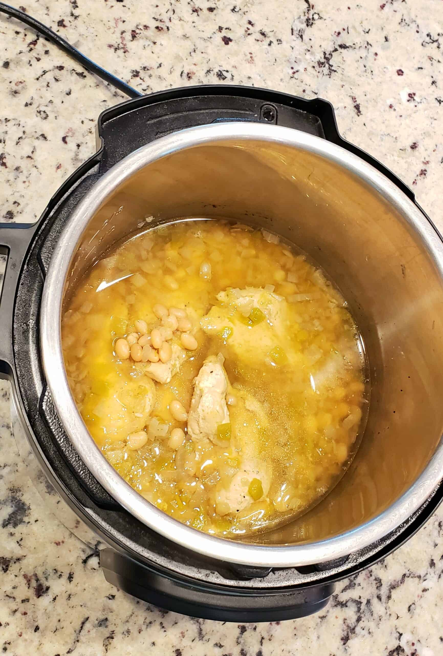 Cooked chicken and bean mixture in the Instant Pot for White Bean and Chicken Chili