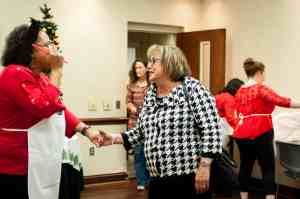 Nena Moorer greeting guests before the Holiday Cooking Show