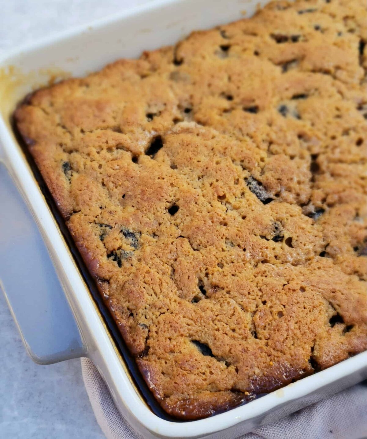 Mission fig cake with sauce in bottom of baking dish