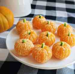 peeled clementine oranges with cucumbers in them to look like pumpkins