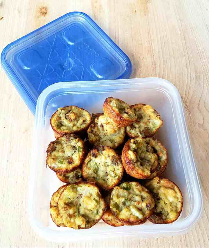 Cornbread dressing baked in muffin cups in a freezer container