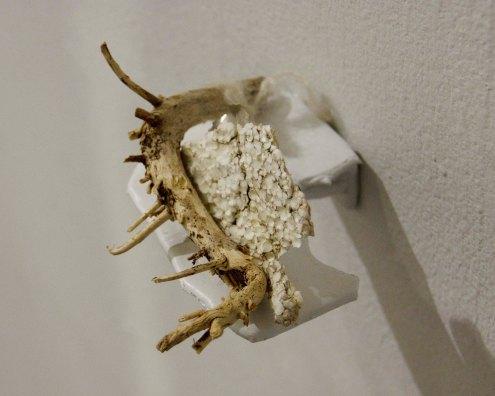 "Jessica Lund-Higgins, sno-cone, 2015 shotgun shell, nylon twine, stuffing, thread, lichen, pin, foam insulation, 3 x 1 x 1"""