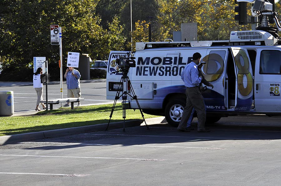 TV news crew staging at parking lot P602