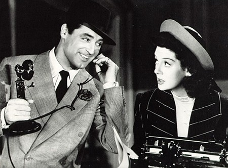 Contact Us - Photo with Cary Grant on telephone and Rosalind Russell on typewriter. Cary Grant is an icon for Groovy Man Stuff and men's style in Silicon Valley.