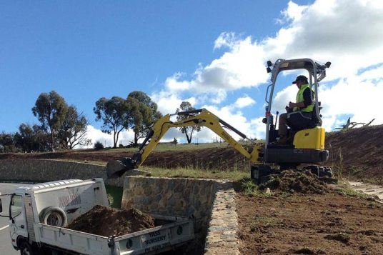 Stripping topsoil Loading mini truck narrow site