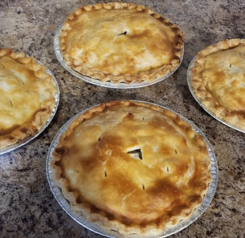 Fresh Baked Tourtiere Pies in individual and family size.