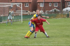 Action as Coxhoe Athletic (red) take on Durham City (yellow) in a pre-season friendly.