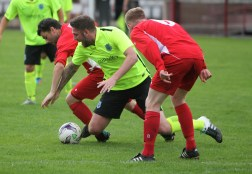 Action as Bedlington Terriers (red) take on Bishop Auckland in the FA Vase.
