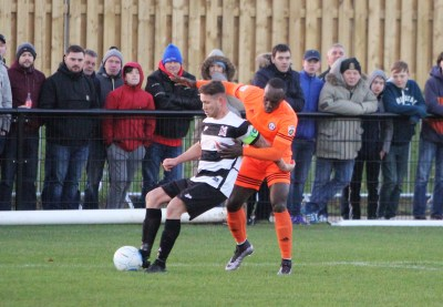 Action as Darlington (black and white) take on Halifax Town at Blackwell Meadows.