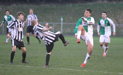 Action as Billingham Synthonia (green & white) take on Tow Law Town.