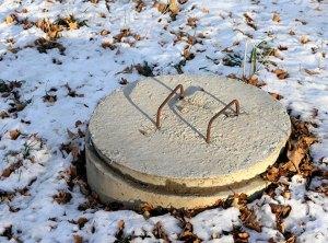 frozen septic tank lid