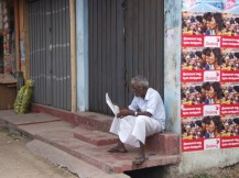 """An elderly person eagerly reads the """"Uthayan"""" Tamil newspaper in the morning"""
