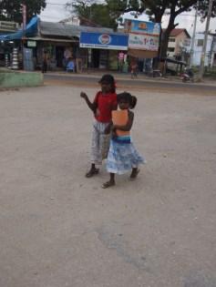 Girl kids going home after tuition at dusk through Chaavakachcheri junction, Jaffna Peninsula