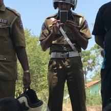 Silavathurai Traffic Police Constable - W.M.Y.M. Warnasooriya (Serial No. 66405) takes pix of protestors and visitors