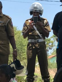 Silavathurai Traffic Police Constable - W.M.Y.M. Warnasooriya (Serial No. 66405) takes pix of protestors and visitors