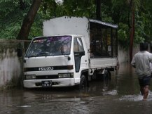 Fruit Vendor's Lorry surrounded by water 2.JPG