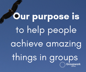 Caption: Our purpose is to help people achieve amazing things in groups. Background: Blue sky with an eagle high above flying with outspread wings