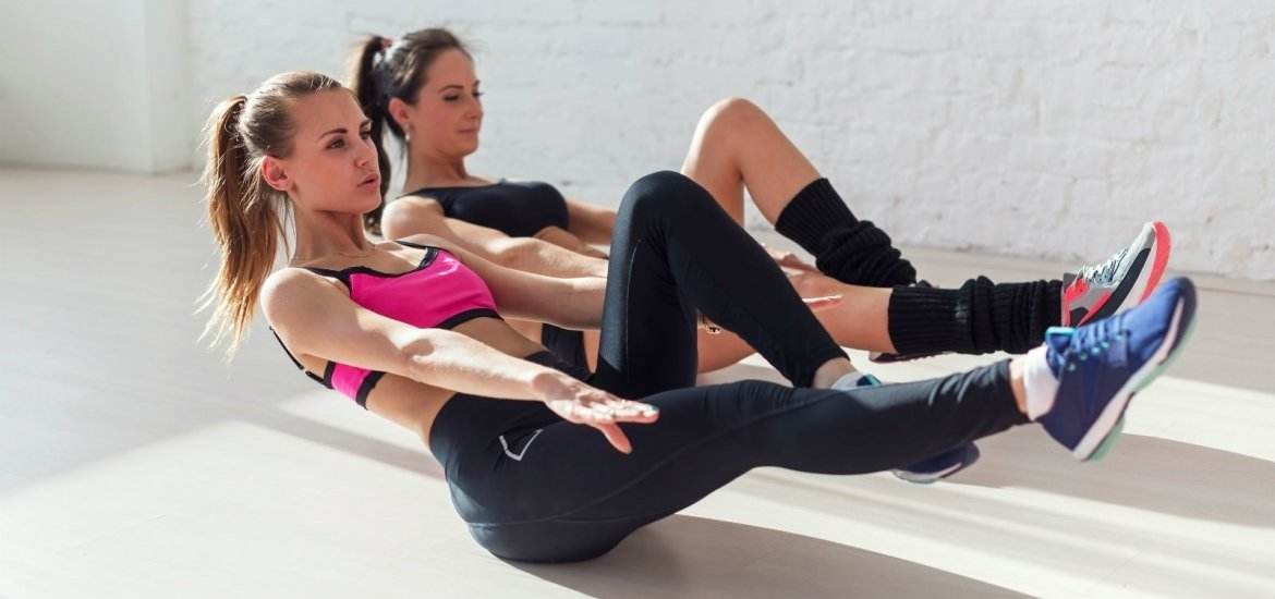 Group fitness instructor leading ab exercises